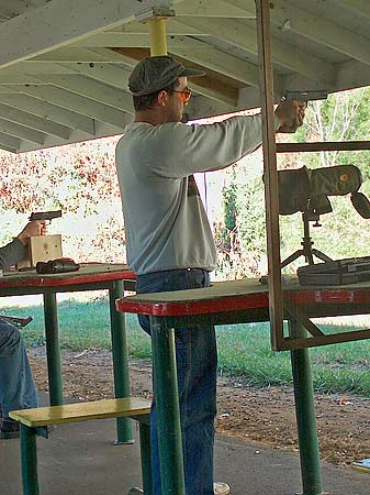 Photograph of Tony shooting a Kimber .45 ACP that his Dad gave him.
